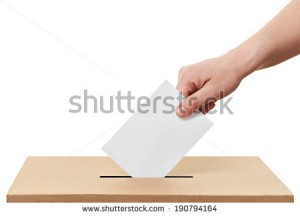 stock-photo-close-up-of-a-ballot-box-and-casting-vote-on-white-background-190794164